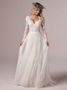 Long sleeve boho lace wedding dress with tulle skirt. Iris is available at the Atlas Bridal Shop. Atlas Bridal Shop is a bridal & wedding dress shop in Toledo, Ohio. Dress designers include Morilee, Allure Bridal, Allure Couture, Maggie Sottero, Rebecca Ingram, Sottero Midgely, Jade, Jade Couture, Cameron Blake, Montage, MGNY and more. Long Wedding Dresses, Colored Wedding Dresses, Boho Wedding Dress, Tulle Wedding, October Wedding Dresses, Lace Sleeve Wedding Dress, A Line Wedding Dress With Sleeves, Prom Dresses, Big Bust Wedding Dress