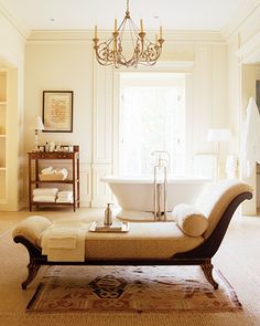 Elegant Bathroom..love the chaise lounge, etc..