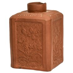 A Rare English Redware Tea Caddy $2,500 Purchase PLACE OF ORIGIN: England DATE OF MANUFACTURE: Circa 1760 PERIOD: 18th Century and Earlier MATERIALS AND TECHNIQUES: Pottery MATERIALS NOTES: Pottery CONDITION: Excellent. Chip to neck, cover lacking. HEIGHT: 4.5 in. (11 cm) WIDTH: 3.25 in. (8 cm) DEPTH: 3.25 in. (8 cm) DEALER LOCATION: New York, NY NUMBER OF ITEMS: 1 REFERENCE NUMBER: 1309178554581