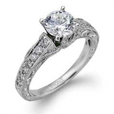 A beautiful diamond solitaire from Simon G. is sure to make any girl say yes!
