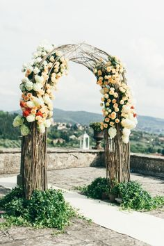 This ceremony backdrop is amazing: http://www.stylemepretty.com/destination-weddings/2015/05/19/traditional-destination-villa-wedding/   Photography: Lisa Poggi - http://www.lisapoggi.com/