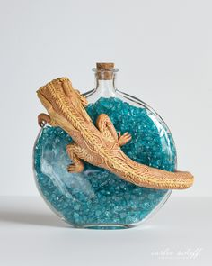 "Medium: Paper Clay & Glass Jar // Display: Free Standing // Size: 7.5"" (width) x 7.5"" (height) x 4"" (depth)"