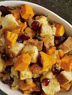 Cranberries add a splash of color and a wealth of flavor to this delectable Thanksgiving stuffing. Recipe: Sourdough Stuffing with Sweet Potatoes and Cranberries   - CountryLiving.com