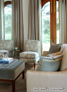 I love the blue tones, silk duponi curtains and the serene feeling of being near the water... whether you really are or not !!! All About Aqua Fabric Collection - Living Room View 1