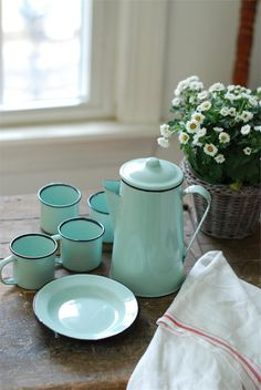 This nine piece Enamelware Petite Serving Set in Robin's Egg Blue has tons of vintage charm. Reminiscent of a camp set, this sweet enamelware collection includes a coffee pot, four small p Shabby Vintage, Shabby Chic, Deco Champetre, Vintage Enamelware, Vintage Crockery, Kitchenware, Tableware, Robins Egg, Robin Egg Blue