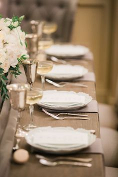 The warm and cozy taupes in this table setting would be lovely for a fall or winter wedding.