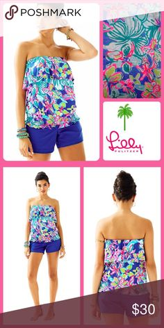 Lilly Pulitzer Katelyn Top in Iris Blue Casa Azul Another great top from Lilly! Strapless top with flounce, and a smocked waist detail. Printed Lightweight Rayon Spandex Jersey Lilly Pulitzer Tops