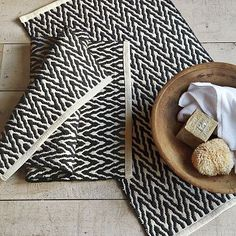 Bath Mat: I love the Dandelion Zig Zag Bath Mat. Only $15 and a great way to add the chevon look without much committment.  By westelm.com