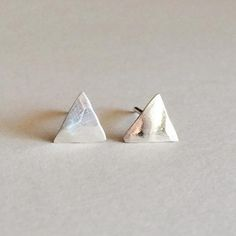 Modern and minimal hammered triangle stud earrings. A simple and versatile pair of earrings that can be worn everyday. Available in sterling silver or 14k gold filled. Earring width: 1/4 inch