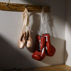 boxing gloves ballet | Boxing gloves and ballet shoes hanging in dressing room - 42-25299516 ...