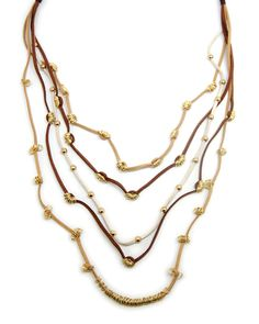 cascading   gold and  leather layered necklace