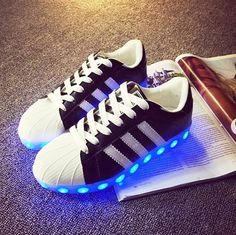 Light up LED shoes! So fun, so unique! Lights charge with USB charger (included with purchase) Lights change colors from purple, to green, to red.    Available in two colors:  -Black  -White    Available in European sizes: 35 - 44    If you are not familiar with European sizing please refer to this chart: http://www1.bloomingdales.com/about/shopping/sizecharts/shoes.jsp    Half sizes not available.    Items will be sent via registered airmail and take approx. 14-30 days to arrive.   Shop…