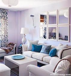 The Decorista-Domestic Bliss: Above the sofa Arrangements...I dig the mirror arrangement