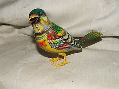 """Vintage-c1954-Tin-Litho-Wind-Up-Singing-Bird-KOHLER-Germany-Clockwork-Movement. Love this one.  Asking $125.00. Description:  OFFERING A circa 1954 TIN LITHOGRAPHED WIND UP""""MERRILY SINGING BIRD"""" BY KOHLER, GERMANY  SEE VIEWS ABOVE  THIS WORKS!  MADE BY GEORG KOHLER, NUREMBERG, GERMANY  KOHLER WAS KNOWN FOR PRODUCING REALISTIC TIN LITHO ANIMALS AND BIRDS WITH CLOCKWORK MOVEMENTS  THEY BEGAN IN BUSINESS IN 1932, FIRSTLY PRODUCINGBIRDS  HE IS ENTIRELY TIN WITH PLASTIC LEGS AND FEET  HE IS…"""