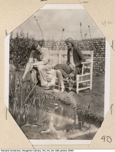 Photograph of John Lehmann and Virginia Woolf sitting on a bench at Monk's House by Leonard Woolf (1931).