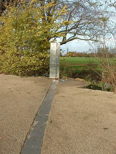 "Kew Meridian line. This is the meridian used for adjusting the instruments in the King's Observatory. The marker is on the Thames towpath between Richmond and Kew. (Photo: Ian Ridpath) ©Mona Evans, ""Kew Observatory"" http://www.bellaonline.com/articles/art20247.asp"