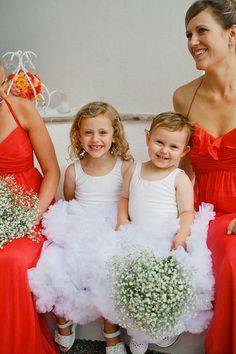 Baby's Breath, Brilliant Red-Orange and Frilly Flower Girls ~ doesn't get ANY better!! Photography by nyholt.com, Event Planning, Floral & Event Design by thedazzlingdetails.com