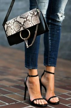 Pair your skinny jeans with a simple high heel ankle strap sandal in the summer. Comfortable and pretty. Via Erica Hoida  Jeans: Dsquared2 Shoes: Saint Laurent, Bag: Chloe  http://www.justthedesign.com/what-shoes-to-wear-with-skinny-jeans-we-have-the-answer/