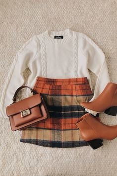 Mad for Plaid Beige Plaid Mini Skirt A plaid skirt outfit is an essential look for winter. The colors of the season come together in a checker pattern throughout the mini skirt. Style with a simple white sweater and ankle booties! Plaid Mini Skirt, Plaid Skirts, Gingham Skirt, Fall Skirts, Skirt Fashion, Fashion Outfits, Womens Fashion, Fashion Flatlay, 2000s Fashion