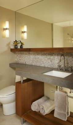 LOVE all the natural elements.  River rock backsplash, that wood shelf, the cement counter...