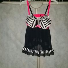 Victory Secret Baby Doll Nwt Victory Secret Baby Doll with matching panties. Top is a 36 C an the panties are a Large. Open back. Victory Secret  Jackets & Coats