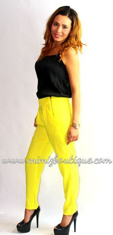 Bright yellow tailored pants with side zips