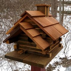 This rustic log cabin for birds is handcrafted in Pennsylvania Dutch country…