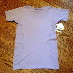 Moisture Wicking Top Brand new. Super comfortable moisture wicking material. Great for running! BNWT! Size L. Light purple color. Bundle with other items in my closet and save 20%! Everlast Tops Tees - Short Sleeve