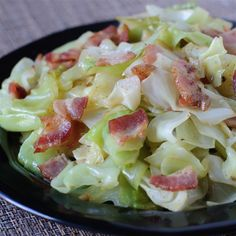 Cabbage fried in bacon grease with bacon.Cook bacon in a deep skillet over medium heat until crisp, 5 to 7 minutes. Remove bacon from skillet and drain on a paper towel-lined plate. Garlic Recipes, Onion Recipes, Irish Recipes, German Recipes, Fried Cabbage Recipes, Bacon Fried Cabbage, Cabbage Meals, Vegetable Dishes, Vegetable Recipes