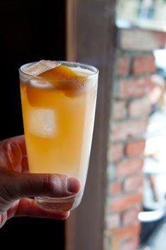 La Nuestra Paloma  2 oz. tequila  1 oz. lime juice  3/4 oz. St. Germain  3/4 oz. Cointreau  1/2 oz. grapefruit juice  3 dashes Angostura bitters  Top with 2 oz. soda  Garnish with a grapefruit peel