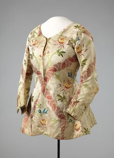 Caraco, Norway, 1770-1789. Cream silk brocade embroidered with flowers and…