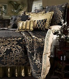 """Everything you love about traditional bed linens just got more interesting with this reversible ensemble from Veratex. The beautiful color mix in black and gold will add bold drama to any bedroom. The comforter features an oversized woven medallion motif and reverses to an allover quilted matte satin. The bedskirt has a 21"""" drop and a braided border trim. Elegant details such as embroidery on the shams, lattice braided trim on the boudoir pillow, and a pleated stripe Euro sham on faux silk…"""