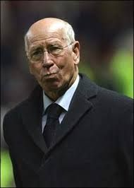 Sir Bobby Charlton; is a former English  football player, regarded as one of the greatest midfielders of all time, and an essential member of the England team who won the World Cup and also won the Ballon d'Or in 1966. He played almost all of his club football at Manchester United, where he became renowned for his attacking instincts and passing abilities from midfield and his ferocious long-range shot.