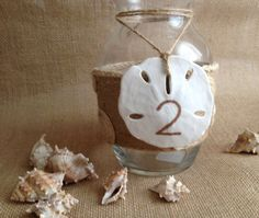 Items similar to Beach wedding table numbers, sand dollar table number on Etsy Beach Wedding Tables, Wedding Table Centerpieces, Wedding Table Numbers, Wedding Reception Decorations, Reception Ideas, Wedding Ideas, Diy Wedding, Wedding Flowers, Wedding Planning