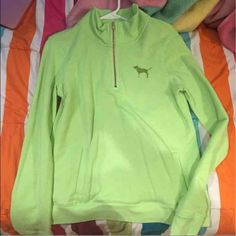 Pink sweater/quarter zip lime green Lime green quarter zip with gold zipper and a gold dog on chest area. The back has love pink written on in white with a little green. The dog has a little bit of green showing through the gold from the washer but it can't be seen unless you're super close. Pocket in the middle lower end of the hoodie/sweater. PINK Victoria's Secret Sweaters