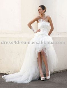 My dream wedding dress style! Short in the front (to show off my legs lol) Then the traditional longness of the back! <3