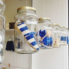 If you were able to hang items in a craft fair book, these hanging jars would really grab shoppers attention and highlight single pieces. (Make sure they're above people's heads or along the wall they don't get bumped into).