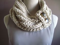 Chunky cowl with decorative buttons. Chain - 90 before enclosing loop (instead of chaining 180 for the double infinity scarf). When finished, crochet over cowl with decorative crochet piece which will hold buttons.