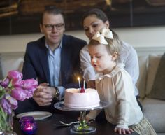 Princess Estelle of Sweden blows out the candles on her birthday cake in new pictures released by the Swedish Royal house. 2/23/2014