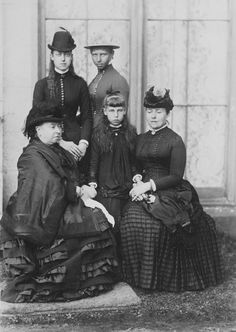 Outside the house at Balmoral, left to right, seated: Queen Victoria; Princess Victoria Melita of Edinburgh; Victoria, Crown Princess of Germany. Standing: Princess Victoria of Wales; Princess Victoria of Prussia.