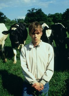 Damon Albarn from the bands Gorillaz and Blur...with cows!