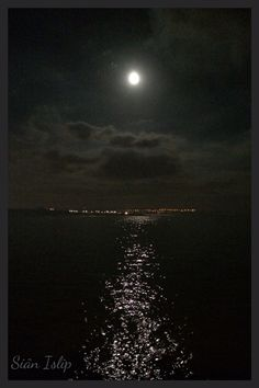 Moonlit View across Coney Beach Porthcawl, towards Ogmore-by-Sea, South Wales. 5th November 2014.