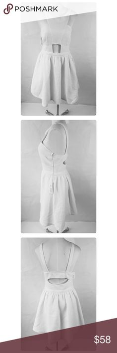 A.drea Textured White Cutout Dress With Pockets A. Drea  CutOut White Dress  Textured Fabric  Side Zip Entry  Size L (11-13) women's (8-10) Pockets!!  Cutout front and back details  Lined  Polyester a.drea Dresses