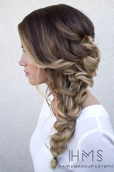 Three braids join together together to make a single braid, which creates a dramatic and elegant formal hairdo. This hairstyle is the perfect romantic braided hair-do for a date night for formal event and will compliment a whimsical dress perfectly.