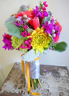 LUMINOSITY - The yellow and pink neon flowers are very illuminious in this bouquet againt the pale greens