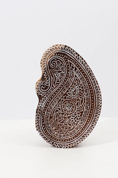 This beautiful hand carved patterned wood block is hand carved from India. It is made out thick sturdy hard wood used for textiles, pottery