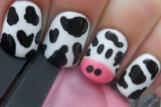 cow nails. I did the spots by touching the brush to my nail then taking a tooth pick with some paint on the end and formed the designs