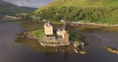 Stunning aerial shot of Eilean Donan castle in the Scottish highlands - stock footage