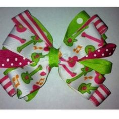 Rock on hair bow! Find more layered bows at www.emmashairbowtique.com