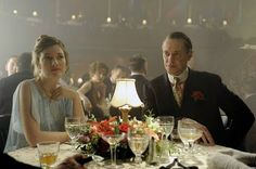 Margaret Schroeder and Nucky Thompson, out for dinner, all dressed up, at Babbette's Supper Club - their favorite place, and the most stylish and lavish restaurant on the Atlantic City Boardwalk at the time - the 1920s during Prohibition.  Margaret is wearing a beautiful baby blue silk chiffon dress with flutter sleeves, and Nucky looks dapper as ever in a dark suit, with peach colored shirt and a brightly colored paisley tie. vintage 1920s era clothing and hairstyles abound on this show.